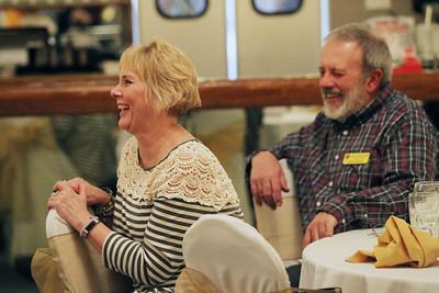 Candace H. Johnson-For Shaw Media Barb and Jim Stout, of Lindenhurst laugh together as Comedian Dan Deibert entertains the crowd during the Lake Villa Township Lions Club Comedy Night at Parkway Banquets in Ingleside. (2/25/19)