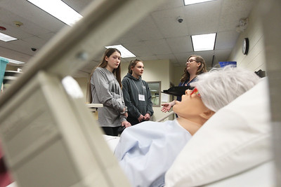 Candace H. Johnson-For Shaw Media Natalie Roper, 14, of Island Lake and Maddie Kist, 16, of Fox River Grove listen to Kari Alford, of Antioch, a nursing student, talk about safe medication administration in the Nursing Simulation Technology Center during STEM for Girls at the College of Lake County in Grayslake. STEM stands for Science, Technology, Engineering and Math. (2/23/19)
