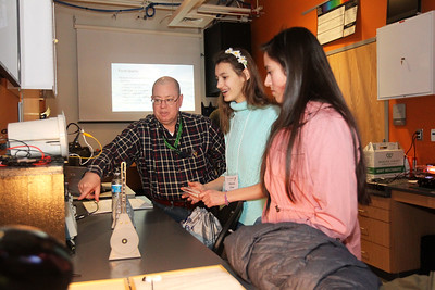 Candace H. Johnson-For Shaw Media Bill Kellerhals, faculty chair, teaches Allyson Crow, 15, of Grayslake and Sadie Sanchez, 14, of North Chicago about different electric and acoustic sound waves during STEM for Girls at the College of Lake County in Grayslake. STEM stands for Science, Technology, Engineering and Math. (2/23/19)