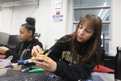 Candace H. Johnson-For Shaw Media Nyanna Stinnette, of Beach Park and Aubrey Tabor, of Barrington, both 14, learn how to make fingers for a prosthetic hand in the Fab Lab during STEM for Girls at the College of Lake County in Grayslake. STEM stands for Science, Technology, Engineering and Math. (2/23/19)
