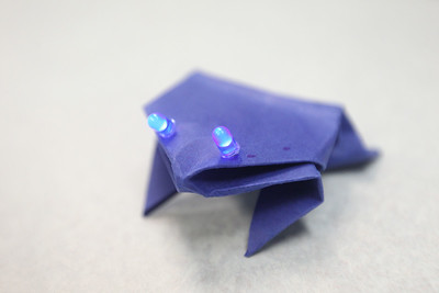 Candace H. Johnson-For Shaw Media A light-up hopping frog is on display to show a finished paper circuit design for students to see while they create one during STEM for Girls at the College of Lake County in Grayslake. STEM stands for Science, Technology, Engineering and Math. (2/23/19)