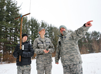 """From left: Cadet Tyler Genengels and Capt. Elizabeth Genengels, both from McHenry, receive instruction from Col. Bob Tyler of Elgin on how to use an """"L-per"""" direction finder to locate a search beacon during the Civil Air Patrol (CAP) Ice Bowl 2020, a cold-weather search and rescue training exercise held by the Illinois Wing of the CAP on Saturday, February 1, 2020 in Gilberts, IL."""