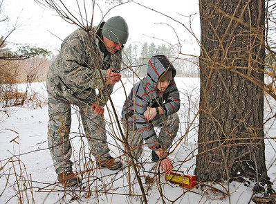 Cadet Hunter Seymour, right, of McHenry, recovers a beacon representing a downed aircraft, while Col. Bob Tyler of Elgin radios in their location during the Civil Air Patrol (CAP) Ice Bowl 2020, a cold-weather search and rescue training exercise held by the Illinois Wing of the CAP on Saturday, February 1, 2020 in Gilberts, IL.