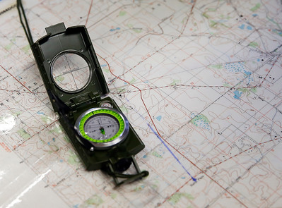 A compass and chart used by the Civil Air Patrol (CAP) in preparation of the CAP Ice Bowl 2020, a cold-weather search and rescue training exercise held by the Illinois Wing of the CAP on Saturday, February 1, 2020 in Gilberts, IL.