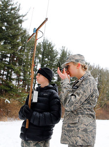 """From left: Cadet Tyler Genengels, of McHenry, uses an """"L-per"""" direction finder while Capt. Elizabeth Genengels, of McHenry, uses an orientation compass to locate a search beacon during the Civil Air Patrol (CAP) Ice Bowl 2020, a cold-weather search and rescue training exercise held by the Illinois Wing of the CAP on Saturday, February 1, 2020 in Gilberts, IL."""