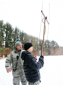 """From left: Col. Bob Tyler of Elgin instructs Cadet Tyler Genengels, of McHenry, on how to use an """"L-per"""" direction finder to locate a search beacon during the Civil Air Patrol (CAP) Ice Bowl 2020, a cold-weather search and rescue training exercise held by the Illinois Wing of the CAP on Saturday, February 1, 2020 in Gilberts, IL."""
