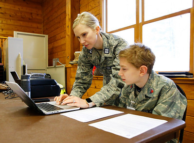 Civil Air Patrol (CAP) Capt. Elizabeth Genengels and her son, Cadet Tyler Genengels, both of McHenry, go over search and rescue techniques in preparation of the CAP Ice Bowl 2020, a cold-weather search and rescue training exercise held by the Illinois Wing of the CAP on Saturday, February 1, 2020 in Gilberts, IL.