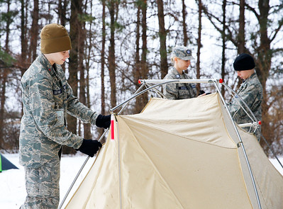 From left: Cadet Hunter Seymour, Capt. Elizabeth Genengels, and Cadet Tyler Genengels, all of McHenry, check on a tent used for winter overnight training at the Civil Air Patrol (CAP) Ice Bowl 2020, a cold-weather search and rescue training exercise held by the Illinois Wing of the CAP on Saturday, February 1, 2020 in Gilberts, IL. Some cadets stayed in the tents Friday night with temperatures dipping to 26 degrees F overnight.