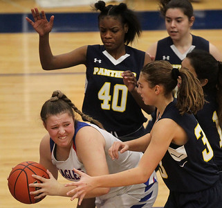 Candace H. Johnson-For Shaw Media Lakes Allison Dietz looks to pass against Round Lake's Jailyn Drane and Lilli Burton in the second quarter at Lakes Community High School in Lake Villa. Round Lake won 42-37.  (2/1/20)