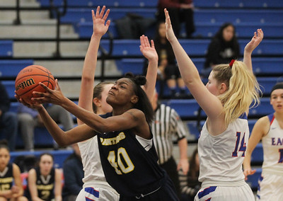 Candace H. Johnson-For Shaw Media Round Lake's Jailyn Drane finds an opening against Lakes Kendall Phelan and Grace Sullivan in the fourth quarter at Lakes Community High School in Lake Villa. Round Lake won 42-37.  (2/1/20)