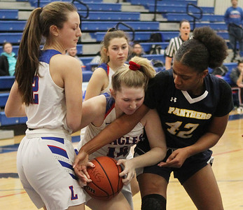 Candace H. Johnson-For Shaw Media Lakes Karlee Skinner stays close to Grace Sullivan as she fights for control with Round Lake's Amari Cole in the third quarter at Lakes Community High School in Lake Villa. Round Lake won 42-37.  (2/1/20)