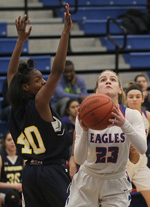 Candace H. Johnson-For Shaw Media Lakes Rosemary Tekampe (#23) looks up for a shot against Round Lake's Jailyn Drane in the first quarter at Lakes Community High School in Lake Villa. Round Lake won 42-37.  (2/1/20)