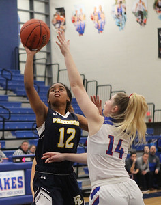Candace H. Johnson-For Shaw Media Round Lake's Ariea Williams goes up for a shot against Lakes Grace Sullivan in the third quarter at Lakes Community High School in Lake Villa. Round Lake won 42-37.  (2/1/20)