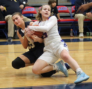 Candace H. Johnson-For Shaw Media Round Lake's Lilli Burton battles for control with Lakes Rosemary Tekampe in the fourth quarter at Lakes Community High School in Lake Villa. Round Lake won 42-37.  (2/1/20)