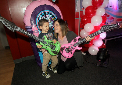 Candace H. Johnson-For Shaw Media Harrison Paquette, 3, of Fox Lake talks to his mother, Heather, before they get their photo taken holding inflatable guitars during the Sock Hop Mother & Son dance at the Lakefront Park Building in Fox Lake. (2/1/20)