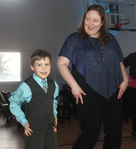 Candace H. Johnson-For Shaw Media Owen Brook, 6, of Round Lake and his mother, Heather, dance the Macarena during the Sock Hop Mother & Son dance at the Lakefront Park Building in Fox Lake. (2/1/20)