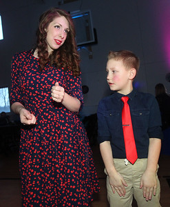 Candace H. Johnson-For Shaw Media Mandy Crain, of Lakemoor and her son, Bentley, 8, try to figure out how to do the hand jive dance during the Sock Hop Mother & Son dance at the Lakefront Park Building in Fox Lake. (2/1/20)