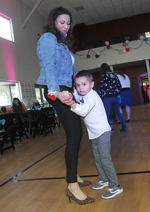 Candace H. Johnson-For Shaw Media Cait Michniewicz, of Fox Lake dances with her son, Eddie, 4, during the Sock Hop Mother & Son dance at the Lakefront Park Building in Fox Lake. (2/1/20)