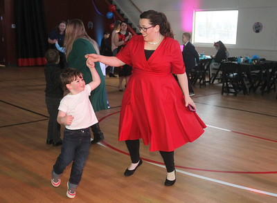 Candace H. Johnson-For Shaw Media Harris Sandri, 3, of Ingleside dances with his mother, Leah, during the Sock Hop Mother & Son dance at the Lakefront Park Building in Fox Lake. (2/1/20)