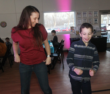 Candace H. Johnson-For Shaw Media Marne Gehring, of Volo and her son, Beckett, dance the Macarena during the Sock Hop Mother & Son dance at the Lakefront Park Building in Fox Lake. (2/1/20)