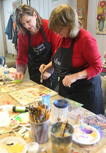 Candace H. Johnson-For Shaw Media Jennifer Evans, of Lake Villa, artist and owner, helps Judy Bock, of Grayslake with her mixed media collage piece with a travel theme during the Paint with Collage class at Periwinkle Art Studio in Lake Villa. Upcoming classes include February 7th : Folk Art Hearts/Valentine Greetings at 6:30 pm. and on February 8-9th: Valentine DIY Weekend. (2/1/20)