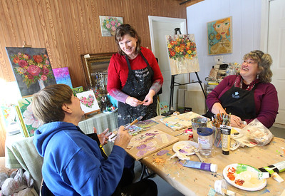Candace H. Johnson-For Shaw Media Jennifer Evans, (center) artist and owner, shares a laugh with Linda Mehnert, of Lake Villa and Shawn Schneider, of Lindenhurst during the Paint with Collage class at the Periwinkle Art Studio in Lake Villa. Upcoming classes include February 7th : Folk Art Hearts/Valentine Greetings at 6:30 pm. and on February 8-9th: Valentine DIY Weekend. (2/1/20)
