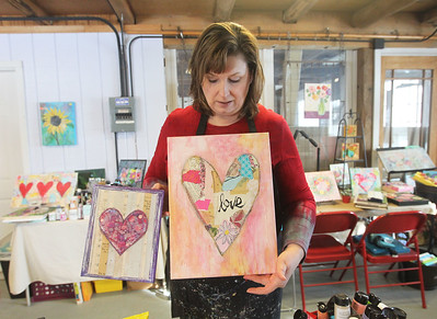Candace H. Johnson-For Shaw Media Jennifer Evans, of Lake Villa, artist and owner, shows the art pieces you can make in upcoming classes in honor of Valentine's Day during the Paint with Collage class at the Periwinkle Art Studio in Lake Villa. Upcoming classes include February 7th : Folk Art Hearts/Valentine Greetings at 6:30 pm. and on February 8-9th: Valentine DIY Weekend. (2/1/20)
