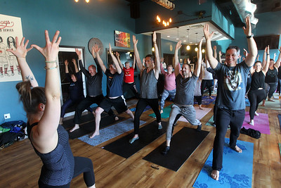 Candace H. Johnson-For Shaw Media Angela Oaks, of Grayslake, a certified yoga instructor, leads her yoga class during Poses and Pints in the taproom at the Tighthead Brewing Company in Mundelein. The yoga class is held at the brewery on the first Sunday of every month at 10:30 am. (2/2/20)
