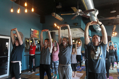 Candace H. Johnson-For Shaw Media Poses and Pints in the taproom at the Tighthead Brewing Company in Mundelein. The yoga class is held at the brewery on the first Sunday of every month at 10:30 am. (2/2/20)