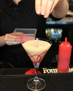 Candace H. Johnson-For Shaw Media Bartender Alisha Aderholt, of Lindenhurst drops some heart-shaped sprinkles into a Heartthrob martini featured for Valentine's Day at The Chocolate Sanctuary Restaurant in Gurnee. (2/11/20)