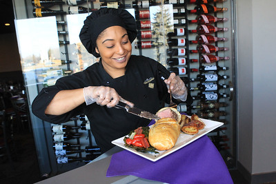 Candace H. Johnson-For Shaw Media Bonita Reyes, of Waukegan, sous chef, cuts into a featured dish she made called, Beef Wellington For Two, which will be on the menu for Valentine's Day at The Chocolate Sanctuary Restaurant in Gurnee. (2/11/20)