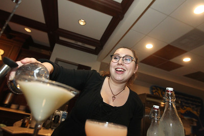 Candace H. Johnson-For Shaw Media Bartender Ashley Smolsnik, of Great Lakes makes drinks called, a New Orleans Fizz and a Pink Lady, for some customers at the bar in the Tasting Room at North Shore Distillery in Green Oaks. (2/8/20)