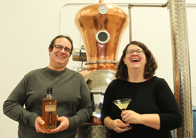 Candace H. Johnson-For Shaw Media Derek and Sonja Kassebaum, co-owners, stand in front of Ethel, the Still, at North Shore Distillery in Green Oaks. Ethel is used to make distilled spirits which include: vodka, gin, whisky and rum. (2/8/20)