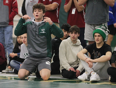 Candace H. Johnson-For Shaw Media Grayslake Central's Adrien Cramer sits close by as he tries to support his brother, Aaron, wrestle Antioch's Devin Nobiling in the 152 lb. weight class during the Class 2A Wrestling Regional Finals at Grayslake Central High School. (2/8/20)