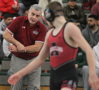 Candace H. Johnson-For Shaw Media Antioch's Wilbur Borrero, head coach, talks to Anthony Streib as he wrestles Wauconda's Jack Sullivan in the 113 lb. weight class during the Class 2A Wrestling Regional Finals at Grayslake Central High School. Antioch's Streib won 7-3 to take first place. (2/8/20)