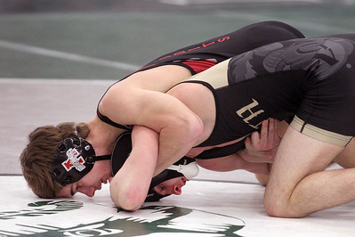 Candace H. Johnson-For Shaw Media Antioch's Luke Menzies battles for control with Grayslake North's Jake Jozwiak as they wrestle in the 126 lb. weight class during the Class 2A Wrestling Regional Finals at Grayslake Central High School. Grayslake North's Jozwiak came in first place as he won by a fall. (2/8/20)