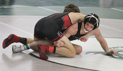 Candace H. Johnson-For Shaw Media Grayslake North's Jack Jozwiak battles for control with Antioch's Luke Menzies in the 126 lb. weight class during the Class 2A Wrestling Regional Finals at Grayslake Central High School.Grayslake North's Jozwiak came in first place and won by a fall. (2/8/20)