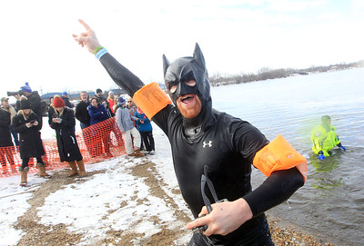 Candace H. Johnson-For Shaw Media Nathan Klauke, of Round Lake, dressed as Batman, makes his way out of the frigid water during the Fox Lake Polar Plunge at Lakefront Park in Fox Lake. Klauke took the plunge with Tish Bulleri, of Trevor, Wis.The event was presented by the Law Enforcement Torch Run to support Special Olympics Illinois. (2/16/20)