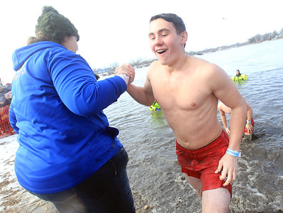 Candace H. Johnson-For Shaw Media Joey Wise with the Grant Bulldogs Athletes team comes out of the icy water during the Fox Lake Polar Plunge at Lakefront Park in Fox Lake. The event was presented by the Law Enforcement Torch Run to support Special Olympics Illinois. (2/16/20)