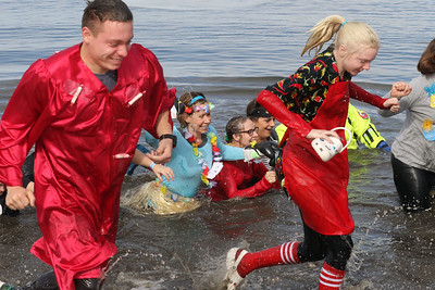 Candace H. Johnson-For Shaw Media Jake Letmanski, of McHenry and his sister, Jessi, run in the frigid water with their Punny Plungers team  during the Fox Lake Polar Plunge at Lakefront Park in Fox Lake. The event was presented by the Law Enforcement Torch Run to support Special Olympics Illinois. (2/16/20)