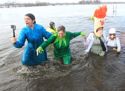 Candace H. Johnson-For Shaw Media Elizabeth Taylor, of Johnsburg, Alison Garcia, of Mundelein, Janine Neumann, of Johnsburg and Erin Flood, of Gurnee with the Lambs Farm team run through the frigid water during the Fox Lake Polar Plunge at Lakefront Park in Fox Lake. The event was presented by the Law Enforcement Torch Run to support Special Olympics Illinois. (2/16/20)