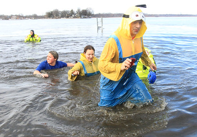 Candace H. Johnson-For Shaw Media Kayla Larsen, Maddy Rose, both of Gurnee and Maddy's father, Michael, run through the frigid water during the Fox Lake Polar Plunge at Lakefront Park in Fox Lake. The event was presented by the Law Enforcement Torch Run to support Special Olympics Illinois. (2/16/20)