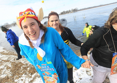 Candace H. Johnson-For Shaw Media Morgan Saam and Vanna Jankowski with the Mundelein PD Frozen 5.0 team come out of the frigid water during the Fox Lake Polar Plunge at Lakefront Park in Fox Lake. The event was presented by the Law Enforcement Torch Run to support Special Olympics Illinois. (2/16/20)