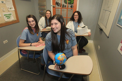 Candace H. Johnson-For Shaw Media The family business includes Jennifer Kenzer, of Libertyville (on right) with her daughters, Samantha, 22, Abby, 16, and Sarah, 18, in the Middle School Madness 60 minute room at Golden Escape Rooms on Commerce Drive in Grayslake. (2/17/20)