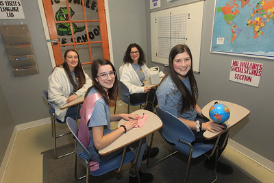 Candace H. Johnson-For Shaw Media The family business includes Jennifer Kenzer, of Libertyville (second from right) with her daughters, Samantha, 22, Abby, 16, and Sarah, 18, in the Middle School Madness 60 minute room at Golden Escape Rooms on Commerce Drive in Grayslake. (2/17/20)