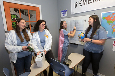 Candace H. Johnson-For Shaw Media The family business includes Jennifer Kenzer, of Libertyville (second from left) with her daughters, Samantha, 22, Abby, 16, and Sarah, 18, as they share a laugh in the Middle School Madness 60 minute room at Golden Escape Rooms on Commerce Drive in Grayslake. (2/17/20)