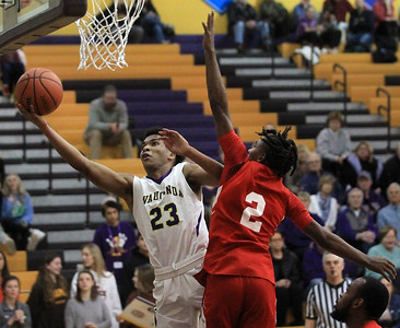 Candace H. Johnson-For Shaw Media Wauconda's Donovan Carter goes up for a shot against North Chicago's Jamar Mays in the fourth quarter at Wauconda High School. Wauconda won 67-58. (2/18/20)