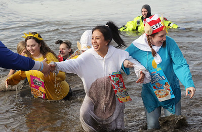 Candace H. Johnson-For Shaw Media Colleen Malec, Gabriela Cervantes and Morgan Saam with the Mundelein PD Frozen 5.0 team make their way out of the frigid water during the Fox Lake Polar Plunge at Lakefront Park in Fox Lake. The event was presented by the Law Enforcement Torch Run to support Special Olympics Illinois. (2/16/20)