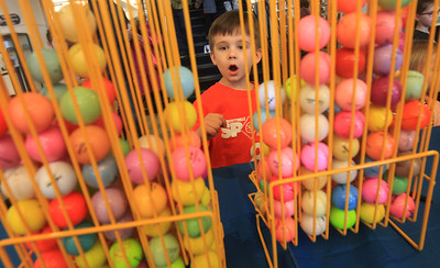 Candace H. Johnson-For Shaw Media Maddox Blair, 5, of Round Lake picks out a colorful golf ball during the Grayslake Library Foundation's 9th Annual MiniGolf Fundraiser at the Grayslake Area Public Library. Maddox was at the library with his father, Jay, and sister, Aubrey, 3.(2/22/20)