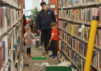 Candace H. Johnson-For Shaw Media Jay Blair, of Round Lake plays mini golf with his children, Aubrey, 3, and Maddox, 5, during the Grayslake Library Foundation's 9th Annual MiniGolf Fundraiser at the Grayslake Area Public Library. (2/22/20)